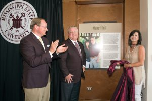 "MSU President Mark E. Keenum, along with Tommy and Terri Nusz, unveil a commemorative plaque in the new G.V. ""Sonny"" Montgomery Center for America's Veterans at Nusz Hall. (Photo by Beth Wynn)"