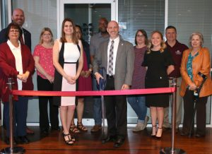 The Montgomery Center for America's Veterans staff led by Director Brian Locke (front row 3rd from right) and MSU-Meridian head of campus Terry Dale Cruse (back row far left) along with MSU-Meridian staff celebrate the opening of a new veteran lounge at MSU-Meridian's College Park Campus. (Photo by Lisa Sollie)